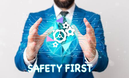 Text sign showing Safety First. Business photo text used to say that the most important thing is to be safe Male human wear formal work suit presenting presentation using smart device