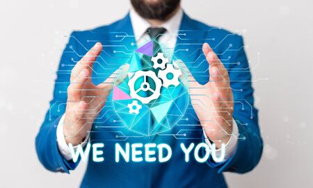 Text sign showing We Need You. Business photo text to fulfill the needs of the assignment duty or obligation Male human wear formal work suit presenting presentation using smart device Imagens