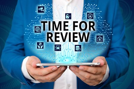 Handwriting text writing Time For Review. Conceptual photo review of a system or situation in its formal examination Male human wear formal work suit presenting presentation using smart device Stock Photo