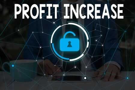 Word writing text Profit Increase. Business photo showcasing the growth in the amount of revenue gained from a business Male human wear formal work suit presenting presentation using smart device