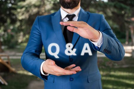 Handwriting text Q And A. Conceptual photo defined as questions being asked and answers Man with opened hands stands in suite. Concept with copy space and man Stock fotó - 129642093