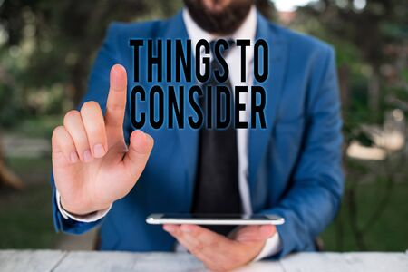 Word writing text Things To Consider. Business photo showcasing think about carefully especially in making decisions Businessman with pointing finger in front of him Stok Fotoğraf