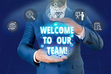 Writing note showing Welcome To Our Team. Business concept for introducing another demonstrating to your team mates Male human wear formal work suit presenting using smart device Banque d'images - 129642121