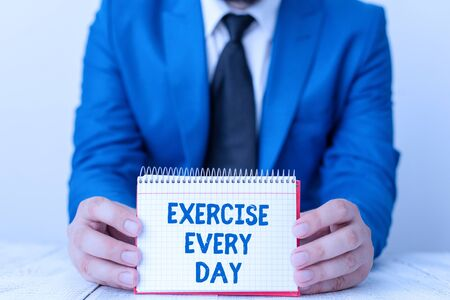 Word writing text Exercise Every Day. Business photo showcasing move body energetically in order to get fit and healthy Man holds empty paper with copy space in front of him Space