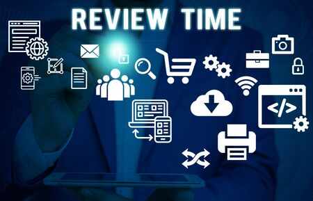 Text sign showing Review Time. Business photo showcasing to think or talk about something again Set schedule to review Male human wear formal work suit presenting presentation using smart device