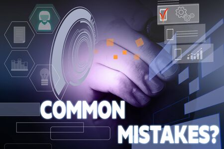 Text sign showing Common Mistakes question. Business photo showcasing repeat act or judgement misguided or wrong Male human wear formal work suit presenting presentation using smart device Stockfoto