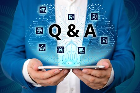 Handwriting text writing Q And A. Conceptual photo defined as questions being asked and answers Male human wear formal work suit presenting presentation using smart device Stock fotó - 129642590