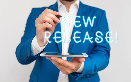 Handwriting text writing New Release. Conceptual photo announcing something newsworthy recent product Businessman with pointing finger in front of him