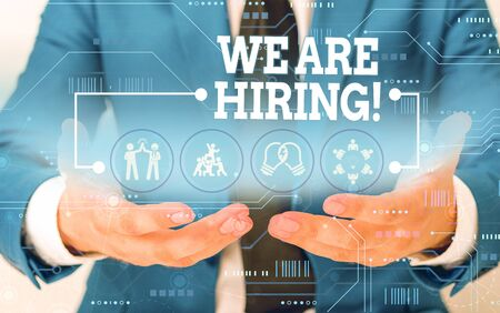 Conceptual hand writing showing We Are Hiring. Concept meaning recently you employ someone or pay someone to do particular job Male wear formal suit presenting presentation smart device Banque d'images - 129642659