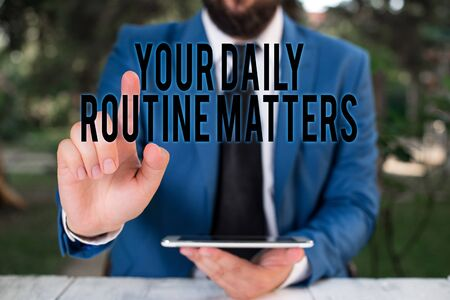 Word writing text Your Daily Routine Matters. Business photo showcasing practice of regularly doing things in fixed order Businessman with pointing finger in front of him