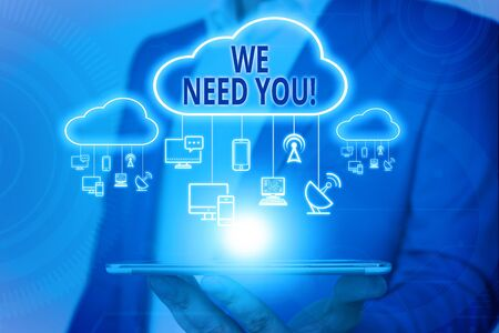 Handwriting text writing We Need You. Conceptual photo asking someone to work together for certain job or target Male human wear formal work suit presenting presentation using smart device
