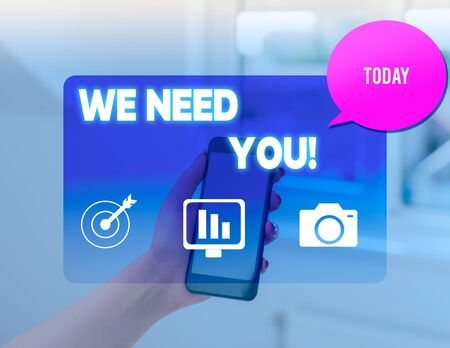 Conceptual hand writing showing We Need You. Concept meaning asking someone to work together for certain job or target woman smartphone speech bubble office supplies technology