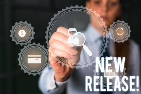 Word writing text New Release. Business photo showcasing announcing something newsworthy recent product Woman wear formal work suit presenting presentation using smart device Foto de archivo - 129418939