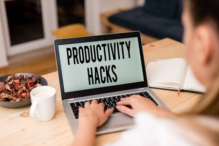 Handwriting text Productivity Hacks. Conceptual photo tricks that you get more done in the same amount of time woman laptop computer smartphone mug office supplies technological devices