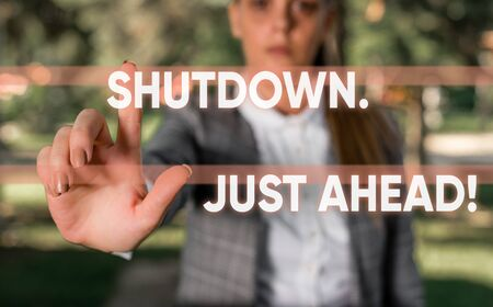 Word writing text Shutdown Just Ahead. Business photo showcasing closing factory business either short time or forever Business woman in the nature pointing with the finger into empty space