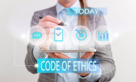 Handwriting text Code Of Ethics. Conceptual photo basic guide for professional conduct and imposes duties Female human wear formal work suit presenting presentation use smart device Stock fotó