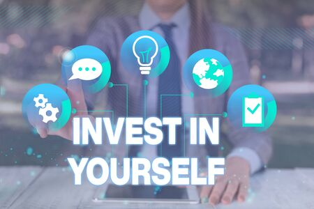 Text sign showing Invest In Yourself. Business photo showcasing learn new things or materials thus making your lot better Female human wear formal work suit presenting presentation use smart device