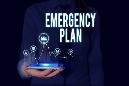 Text sign showing Emergency Plan. Business photo text procedures for handling sudden or unexpected situations Woman wear formal work suit presenting presentation using smart device