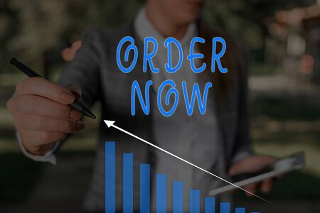 Word writing text Order Now. Business photo showcasing the activity of asking for goods or services from a company Woman wear formal work suit presenting presentation using smart device