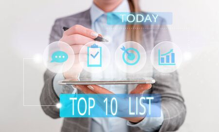 Handwriting text Top 10 List. Conceptual photo the ten most important or successful items in a particular list Female human wear formal work suit presenting presentation use smart device