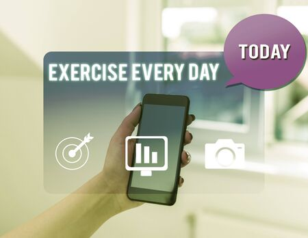 Text sign showing Exercise Every Day. Business photo text move body energetically in order to get fit and healthy woman icons smartphone speech bubble office supplies technological device 写真素材