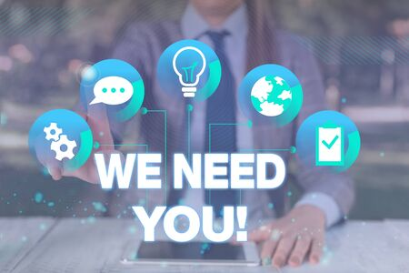 Text sign showing We Need You. Business photo showcasing asking someone to work together for certain job or target Female human wear formal work suit presenting presentation use smart device 写真素材