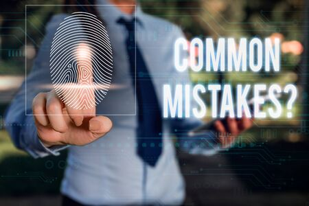 Conceptual hand writing showing Common Mistakes question. Concept meaning repeat act or judgement misguided or wrong Woman wear work suit presenting presentation smart device