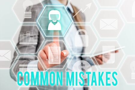 Writing note showing Common Mistakes. Business concept for actions that are often used interchangeably with error Lady front presenting hand blue glow futuristic modern technology