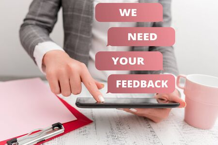 Text sign showing We Need Your Feedback. Business photo text criticism given to say can be done improvement Business concept with mobile phone in the hand