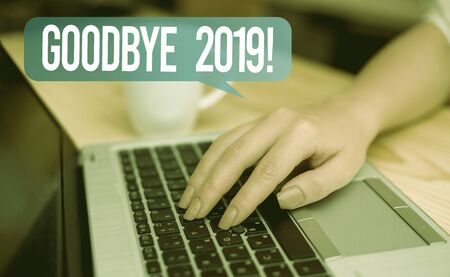 Word writing text Goodbye 2019. Business photo showcasing express good wishes when parting or at the end of last year woman laptop computer smartphone mug office supplies technological devices