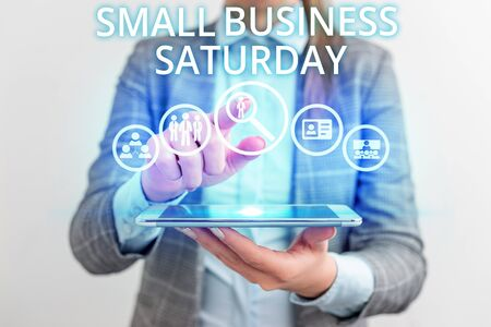 Conceptual hand writing showing Small Business Saturday. Concept meaning American shopping holiday held during the Saturday Lady front presenting hand blue glow futuristic modern technology