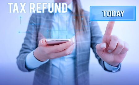 Word writing text Tax Refund. Business photo showcasing refund on tax when the tax liability is less than the tax paid Lady front presenting hand blue glow futuristic modern technology tech look Stock Photo