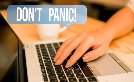 Word writing text Don T Panic. Business photo showcasing suddenly feel so worried or frightened that you can not behave woman laptop computer smartphone mug office supplies technological devices