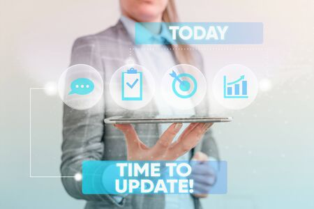 Writing note showing Time To Update. Business concept for this is right moment to make something more modern new Female human wear formal work suit presenting smart device Фото со стока