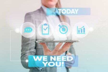 Writing note showing We Need You. Business concept for asking someone to work together for certain job or target Female human wear formal work suit presenting smart device 写真素材