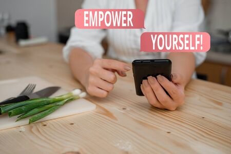 Conceptual hand writing showing Empower Yourself. Concept meaning taking control of our life setting goals and making choices woman using smartphone and technological devices inside home