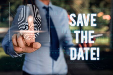 Conceptual hand writing showing Save The Date. Concept meaning Organizing events well make day special event organizers Woman wear work suit presenting presentation smart device Фото со стока