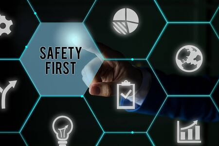 Text sign showing Safety First. Business photo showcasing used to say that the most important thing is to be safe Male human wear formal work suit presenting presentation using smart device
