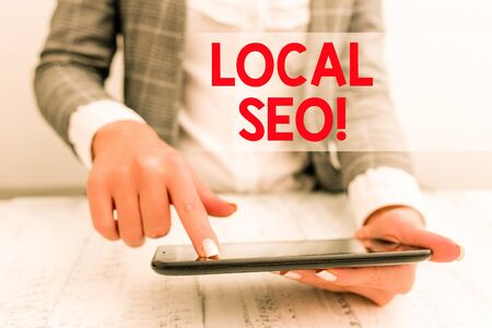Word writing text Local Seo. Business photo showcasing incredibly effective way to market your near business online Business concept with mobile phone in the hand
