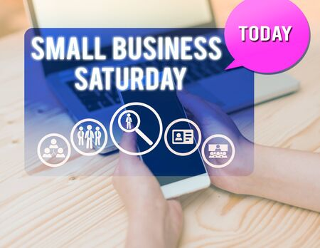 Conceptual hand writing showing Small Business Saturday. Concept meaning American shopping holiday held during the Saturday woman smartphone speech bubble office supplies technology 写真素材