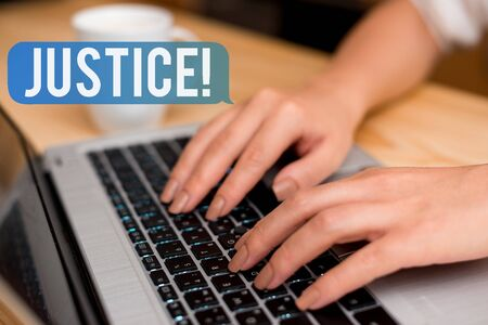 Handwriting text Justice. Conceptual photo impartial adjustment of conflicting claims or assignments woman laptop computer smartphone mug office supplies technological devices