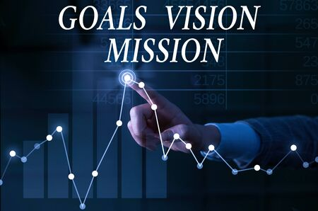 Text sign showing Goals Vision Mission. Business photo showcasing practical planning process used to help community group Lady presenting hand blue glow futuristic modern technology tech graph economy 스톡 콘텐츠