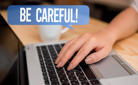 Word writing text Be Careful. Business photo showcasing making sure of avoiding potential danger mishap or harm woman laptop computer smartphone mug office supplies technological devices