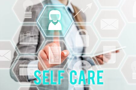 Writing note showing Self Care. Business concept for the practice of taking action to improve one s is own health Lady front presenting hand blue glow futuristic modern technology Stock fotó