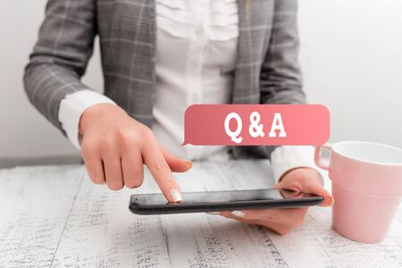 Handwriting text writing Q And A. Conceptual photo defined as questions being asked and answers Business concept with mobile phone in the hand Stock fotó