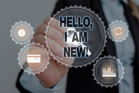 Text sign showing Hello I Am New. Business photo text used as greeting or to begin telephone conversation Woman wear formal work suit presenting presentation using smart device Фото со стока