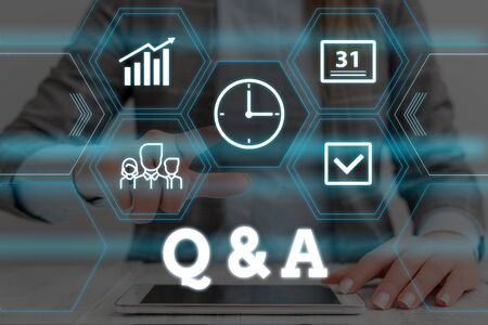 Handwriting text Q And A. Conceptual photo defined as questions being asked and answers Woman wear formal work suit presenting presentation using smart device Stock fotó - 129615824