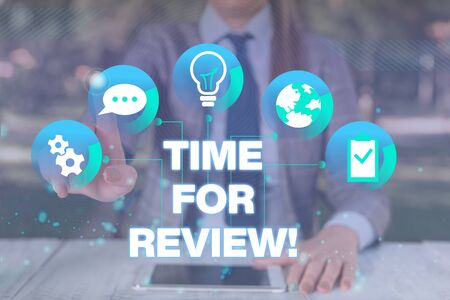 Text sign showing Time For Review. Business photo showcasing formal assessment of something with intention instituting change Female human wear formal work suit presenting presentation use smart device Stock Photo