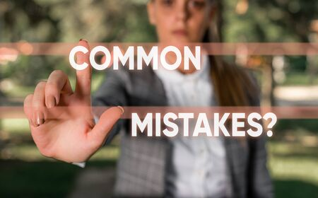Word writing text Common Mistakes Question. Business photo showcasing repeat act or judgement misguided making something wrong Business woman in the nature pointing with the finger into empty space Stockfoto