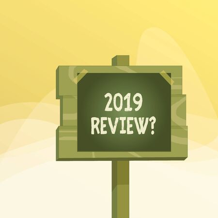 Writing note showing 2019 Review Question. Business concept for remembering past year events main actions or good shows Wood plank wood stick pole paper note attached adhesive tape 版權商用圖片